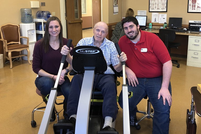 Hal Hess with Randee O'Brien, director of rehab, left, and Kellen Lewis, occupational therapist