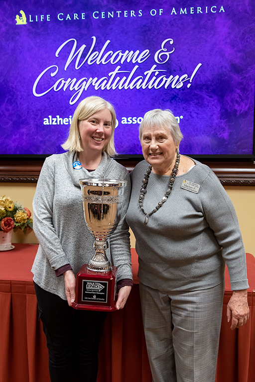 Kristi Mendoza and Marilyn Finch ready to take the Alzheimer's fundraising trophy back to The Highlands