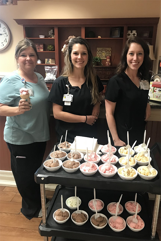 Marva Smith, Jennifer Newman and Bailey Gann, LPNs at Life Care Center of Hixson, prepare to deliver ice cream.