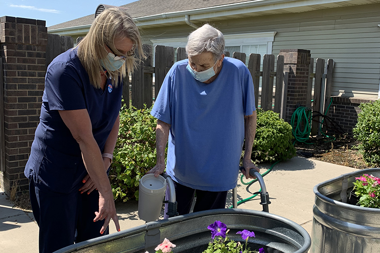 Gardening builds strength for Karen Ramey at Life Care Center of Wichita