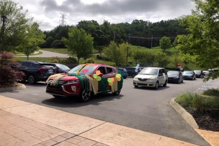 Hawaiian car parade reunites families at Life Care Center of Blount County